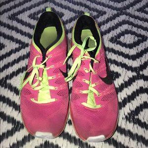 Pink nike flyknit one sneakers